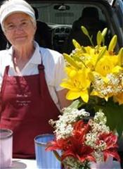 Woman with Flowers at Local Farmers' Market